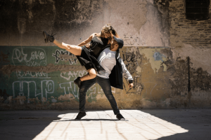 Man and Woman performing a dance routine